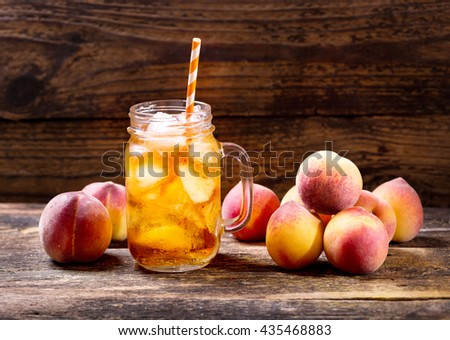 jar of peach iced tea with fresh fruit