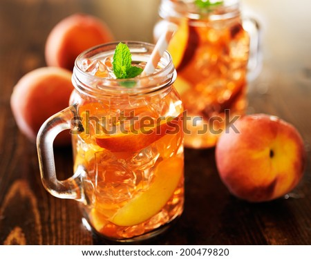 jar of peach tea shot with selective focus - stock photo