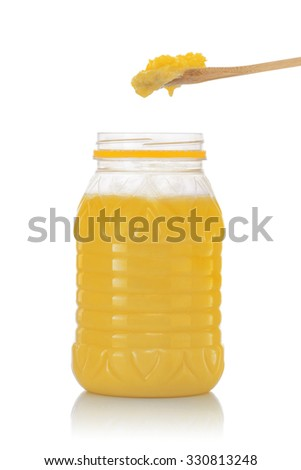 Jar of Pure Indian Ghee with Spoon Isolated on White Background - stock photo