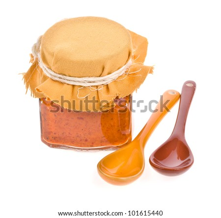 Jar of sauce from the pepper  on white background - stock photo