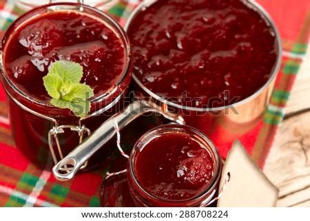Jar of strawberry jam - stock photo