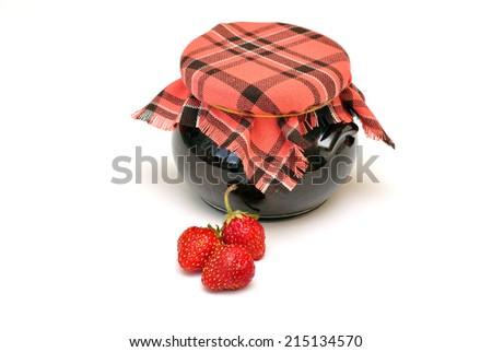 jar of strawberry jam cooked in grandmother's recipe with fresh cherry - stock photo