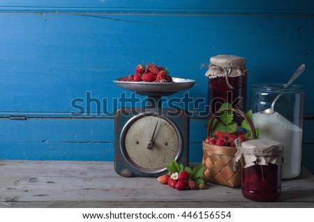 Jar of tasty homemade strawberry preserve - stock photo