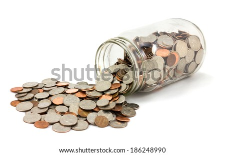 Jar of US coins spilled on a white background - stock photo