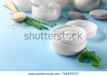 Jar with body cream on table
