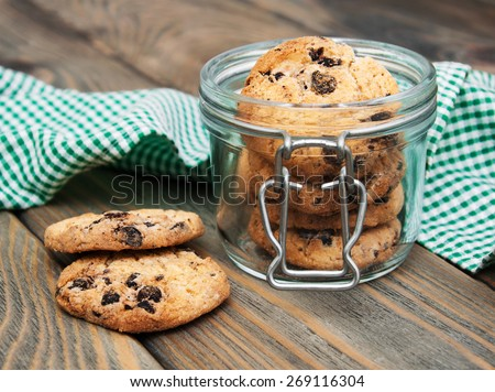 Jar with Chocolate cookies on a wooden background - stock photo