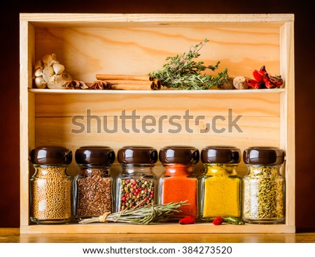 jar with cooking spices and ingredients pepper garlic paprika curry - Spice Jars