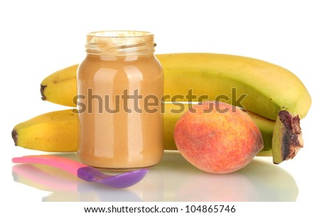 Jar with fruit and baby food and spoon isolated on white