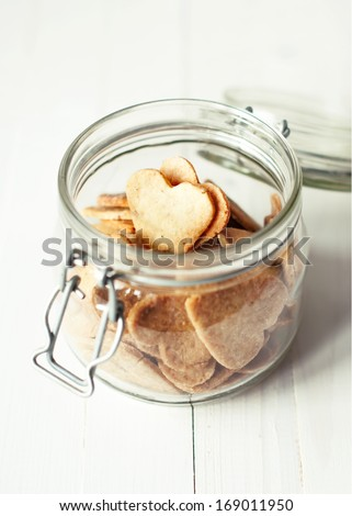 Jar with Hearts Cookies on white wooden table, selective focus - stock photo