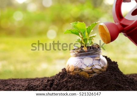 Jar with money and watering can above it present money saving concept