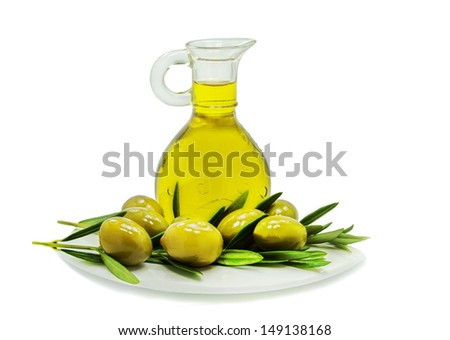 Jar with olive oil and fruits on white saucer