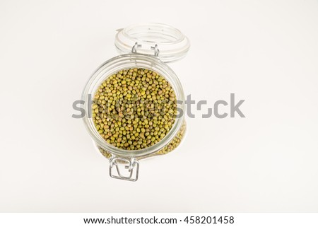 Jar with open lid full of soy beans