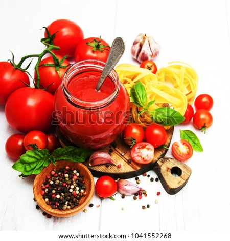 Jar with tomato sauce on a table