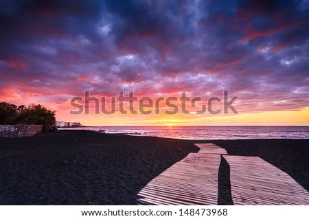 Jardin Beach at sunset (Puerto de la Cruz, Tenerife, Canary Islands, Spain) - stock photo