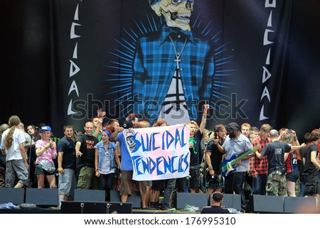 JAROCIN, POLAND- JULY 20: Suicidal Tendencies at live concert. The audience came on stage and sing along with the band. Rock Festival Jarocin 2013, Poland - stock photo