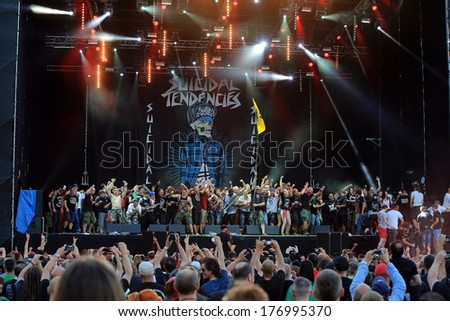 JAROCIN, POLAND - JULY 20: Suicidal Tendencies at live concert. The audience came on stage and sing along with the band. Rock Festival Jarocin 2013, Poland. - stock photo