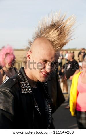 JAROCIN, POLAND - JUNE 22: An unidentified fan of rock and punk music at Jarocin Festival in Poland on June 21, 2012 in Jarocin in Poland - stock photo