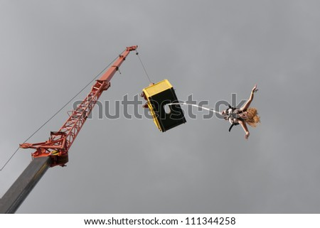 JAROCIN, POLAND - JUNE 22: An unidentified naked fan of rock and punk music jumps on bungee at Jarocin Festival in Poland on June 21, 2012 in Jarocin in Poland - stock photo