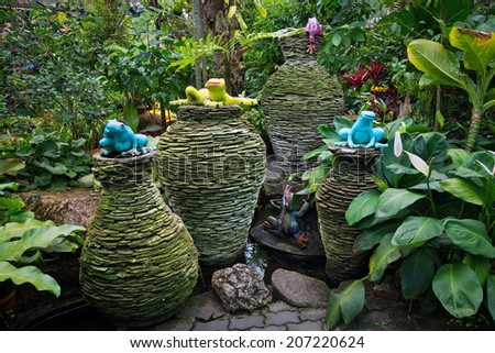 Jars and decorated with a fountain in the park. - stock photo