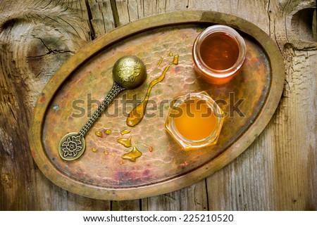 Jars of honey,vintage spoon - stock photo