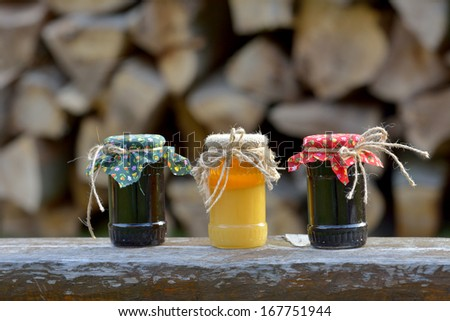 Jars of jam on wooden board  - stock photo