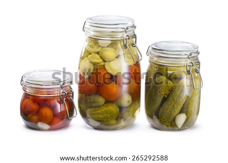 Jars of pickled marinade vegetables tomato, cucumbers and squash isolated on white. Marinated food - stock photo