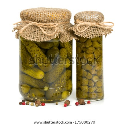 jars of pickles and capers - stock photo