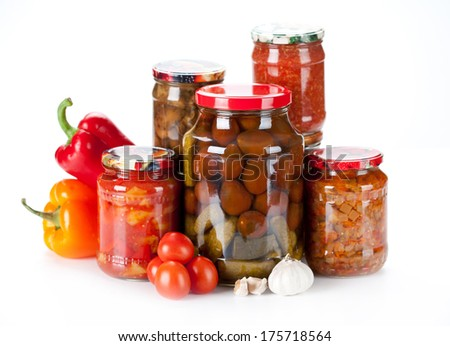 jars with different kind of pickles, home made  - stock photo