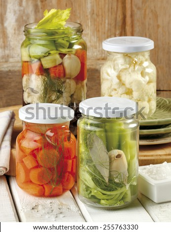 Jars with fresh artisan homemade pickled vegetables - stock photo