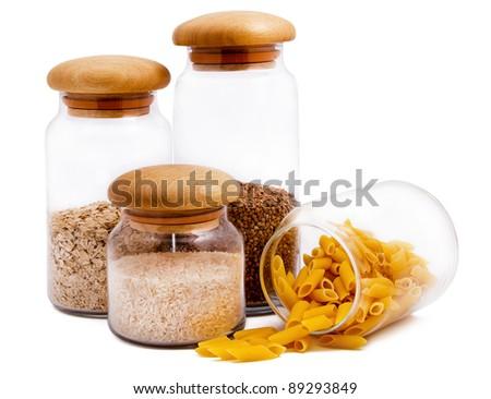 Jars with macaroni, rice, buckwheat and oatmeal isolated on white - stock photo