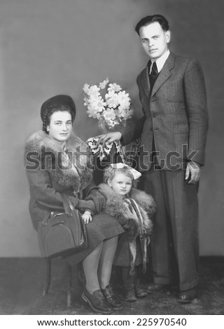 JASLO,POLAND - CIRCA 1948: - vintage family photo of couple with their daughter