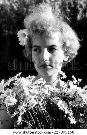 JASLO,POLAND - CIRCA 1959 : vintage photo of girl with flowers