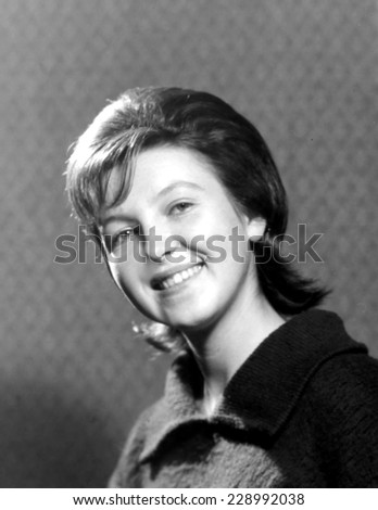 JASLO,POLAND - CIRCA 1963 : vintage photo of smiling young woman wawed hair