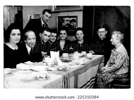 JASLO, POLAND - CIRCA 1943: vintage photo of wedding family party