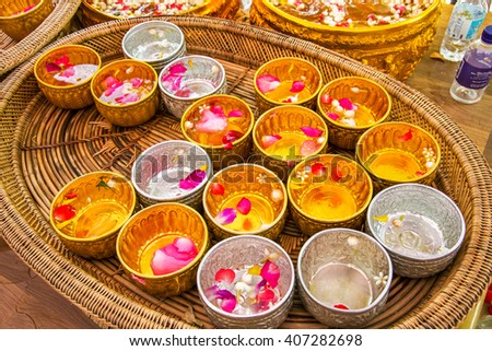 Jasmine and Rose Petals floating on surface of water, in a silver bowl. Elements on Songkran, Thailand's New Year Holiday Festival (Water Blessing Ceremony)  - stock photo