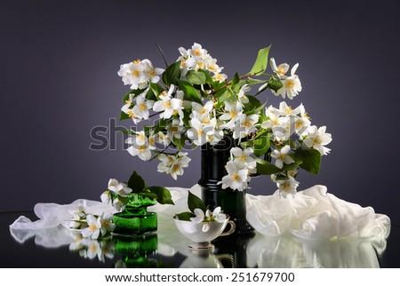 Jasmine bouquet in the vase on dark background - stock photo