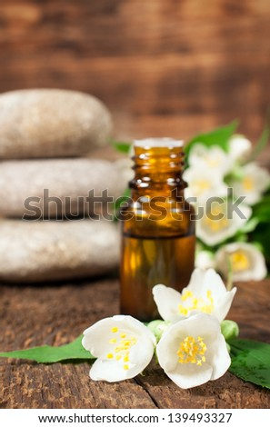 Jasmine essential oil for aromatherapy on a wooden background