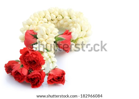 Jasmine garland with red rose buds pack important guest and respected. isolated on white background with clipping path. - stock photo