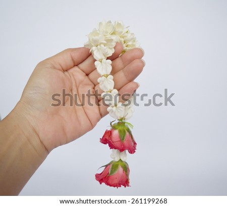 Jasmine garland with red rose, Thai flower name Malai - stock photo