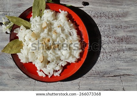 Jasmine rice cooked on red plate - stock photo