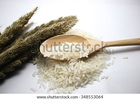 Jasmine rice in a wooden spoon.