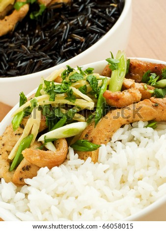 Jasmine rice with chicken and vegetables. Shallow dof. - stock photo