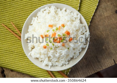 Jasmine rice with chopsticks on a fabric mat - stock photo