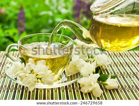 Jasmine tea pouring in a glass cup  - stock photo