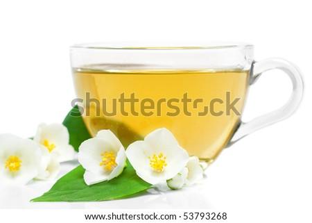 jasmine tea with fresh jasmine leaves and flowers - stock photo