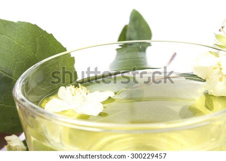 Jasmine tea with jasmine flowers very close