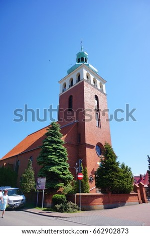 JASTARNIA, POLAND - JUNE 19, 2017: Church building with tower in the town center