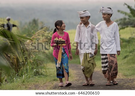 Jatiluwih, Tabanan, Bali, Indonesia - May 14, 2017 : Going home from the morning ceremony