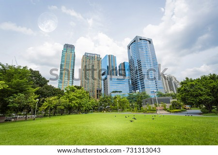jatujak park with modern building background in Bangkok Thailand