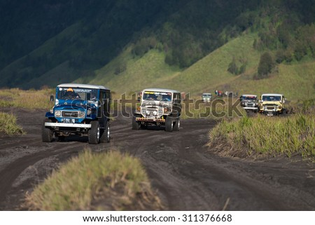 JAVA - INDONESIA, April 22 : tourist jeep cars driving on track to Bromo volcano ,Java Indonesia, April 22,2015